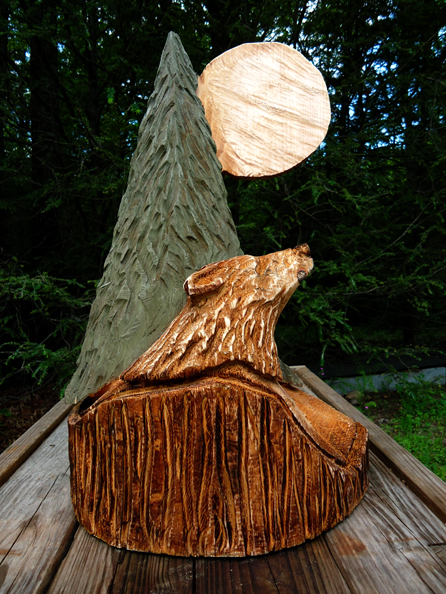 Ross macvicar: chainsaw artist chainsaw carvings of moon angel more